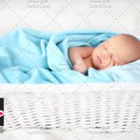 تصویر با کیفیت نوزاد خوابیده در سبد