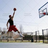 تصویر استوک ورزش بسکتبال و پرتاب بازیکن